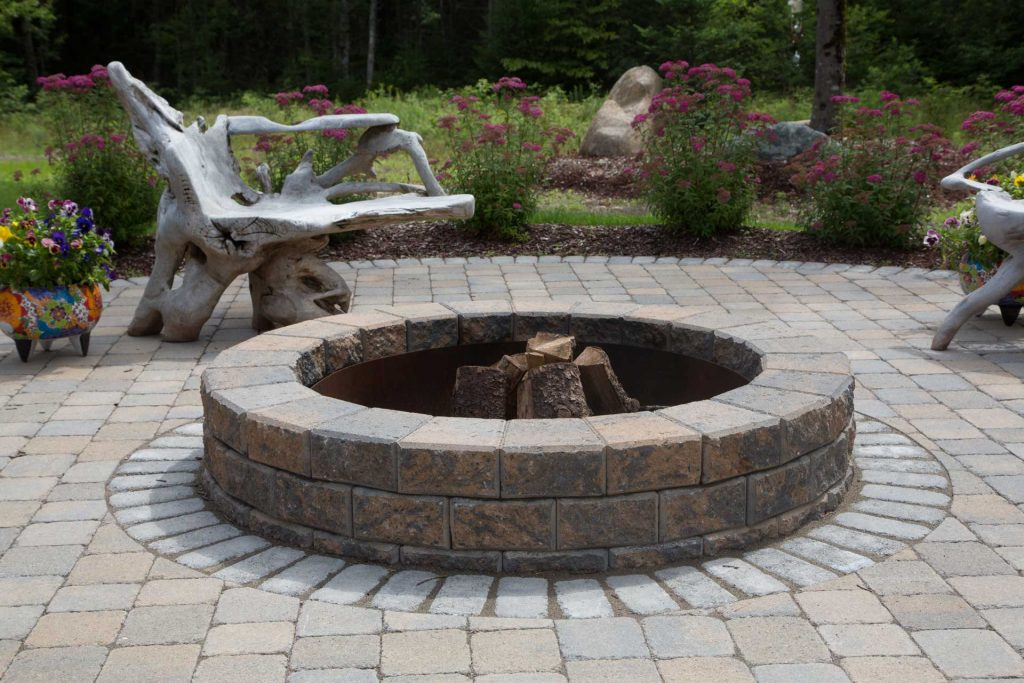 nantucket fire pit on display in a backyard setting
