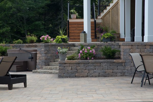 Back patio of a home featuring Shaw Brick's Tumbled WallStone products