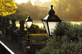 Two outdoor lights in a garden